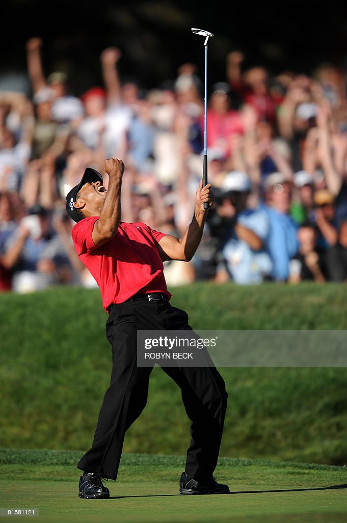 Tiger Woods of the US celebrates his birdie putt on the 18th hole in the fourth round of the 108th U.S. Open golf tournament forcing a playoff with compatriot Rocco Mediate at Torrey Pines Golf Course in San Diego, California on June 15, 2008.