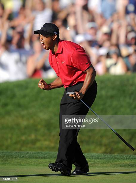 Tiger Woods of the US celebrates his birdie putt on the 18th hole in the fourth round of the 108th US Open golf tournament forcing a playoff with...