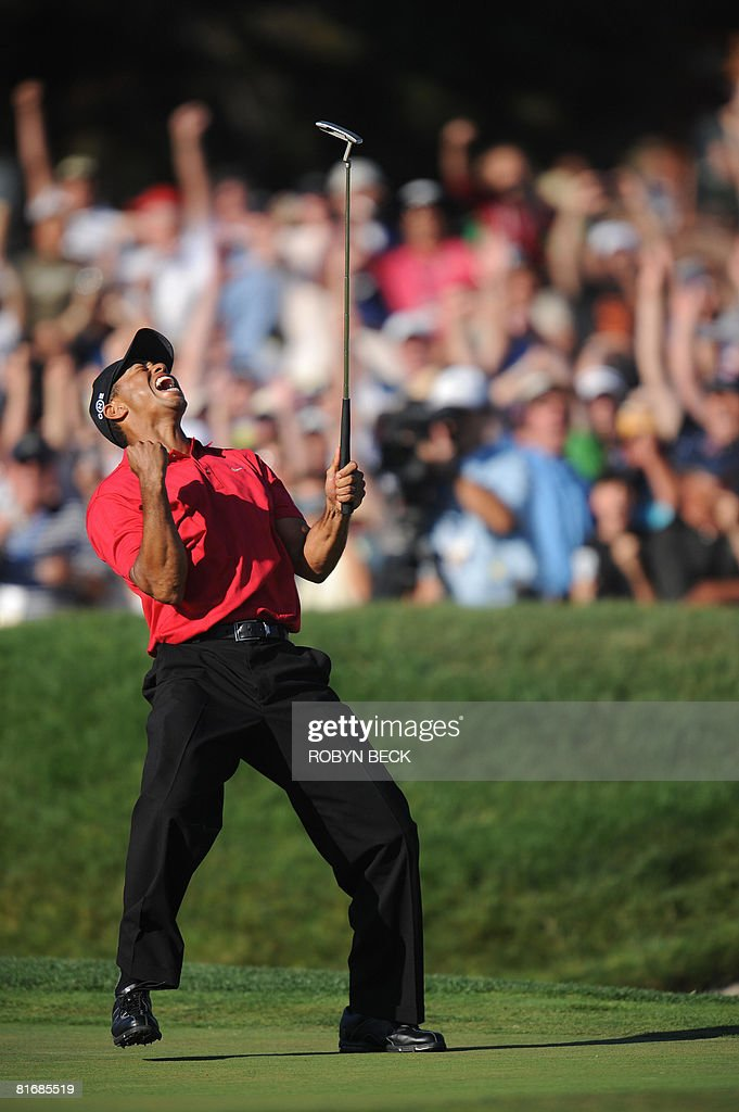 Tiger Woods of the US celebrates his birdie putt on the 18th hole in the fourth round of the 108th U.S. Open golf tournament at Torrey Pines Golf Course in San Diego, California on June 15, 2008. Woods' finished tied for the lead with compatriot Rocco Mediate, forcing a playoff which will take place on June 16.