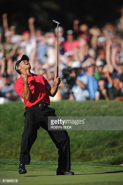 Tiger Woods of the US celebrates his birdie putt on the 18th hole in the fourth round of the 108th US Open golf tournament at Torrey Pines Golf...