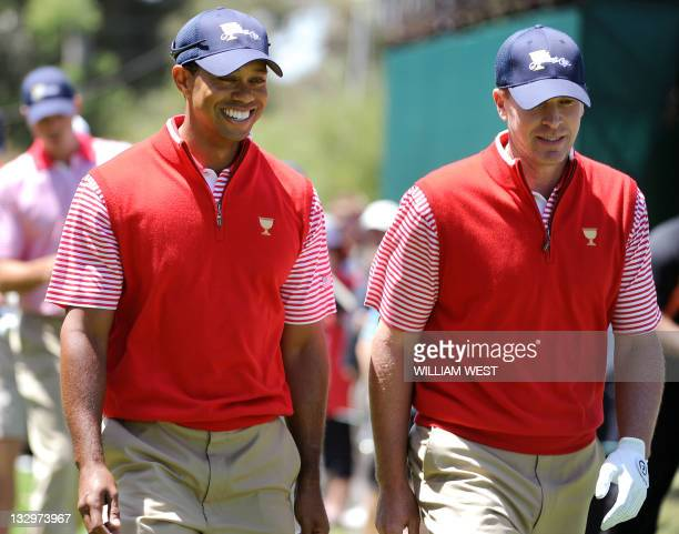 Tiger Woods of the US chats with teammate Steve Stricker during a practice round as the US prepares to take on the Invitational team at the...