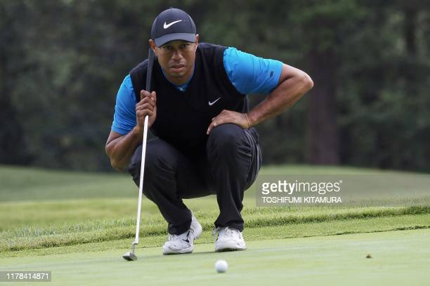 TOPSHOT Tiger Woods of the US checks the line on the second hole green during the third round of the PGA Zozo Championship golf tournament at the...