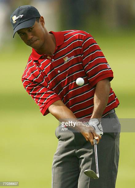 Tiger Woods of the US Chips on the 10th hole during the practice round at The Royal Montreal Golf Club host of the 2007 President's Cup 26 September,...