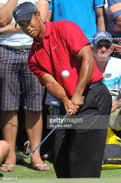 Tiger Woods of the US chips the ball onto the green on the way to winning the Australian Masters golf tournament during the final round at the...