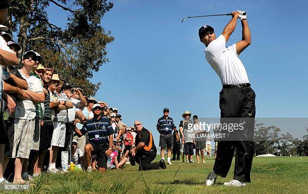 Tiger Woods of the US hits a ball to the green during the proam for the Australian Masters tournament at the Kingston Heath golf course his first...
