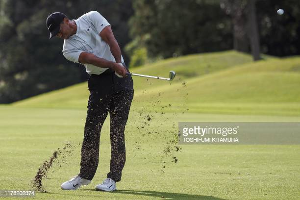 TOPSHOT Tiger Woods of the US hits a second shot at the 12th hole fairway during the second round of the PGA Zozo Championship golf tournament at the...