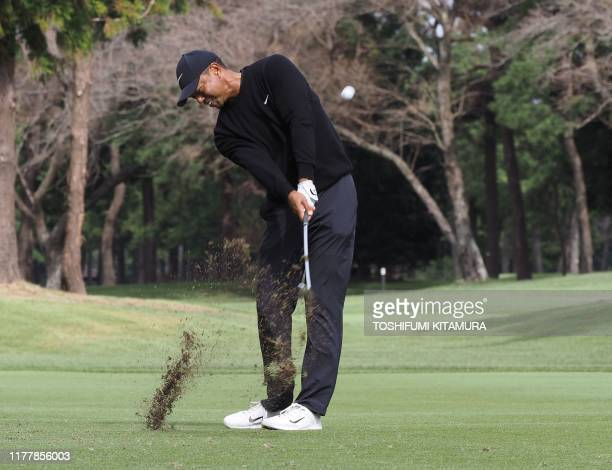 TOPSHOT Tiger Woods of the US hits a second shot at the second hole during the first round of the Zozo Championship golf tournament at the Narashino...