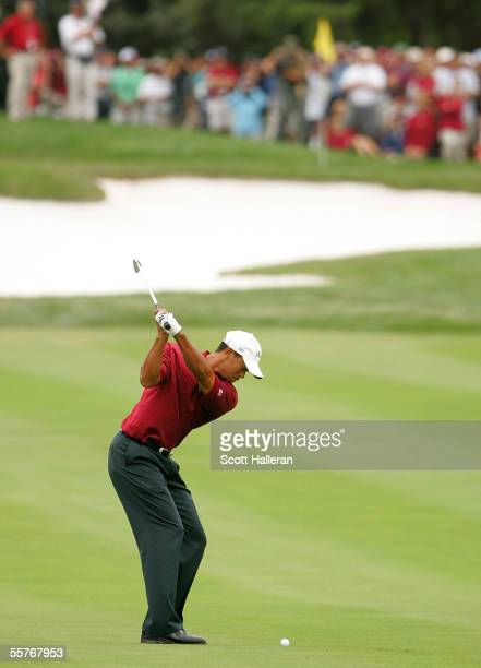 Tiger Woods of the US hits his approach shot on the first hole during the Sunday Singles Matches at the 2005 Presidents Cup on September 25 2005 at...
