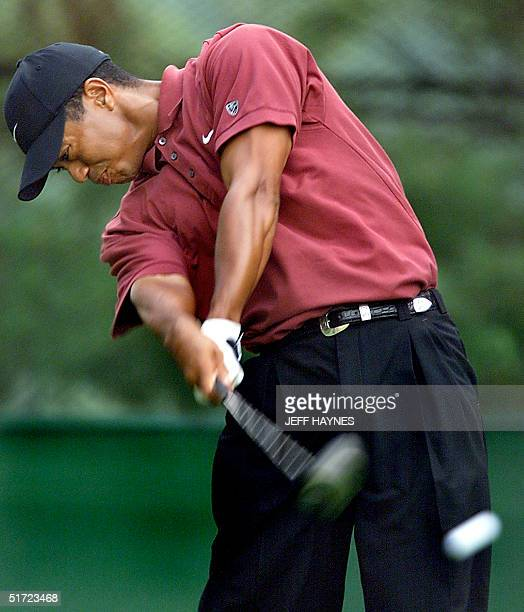 Tiger Woods of the US hits his tee shot on the second hole 26 August 2001 during the final round of the World Golf ChampionshipsNEC Invitational at...