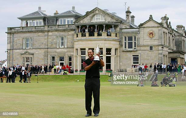 Tiger Woods of the US holds the Claret Jug after winning the 134th Open Championship on the Old Course in St. Andrews, Scotland, 17 July, 2005. AFP...