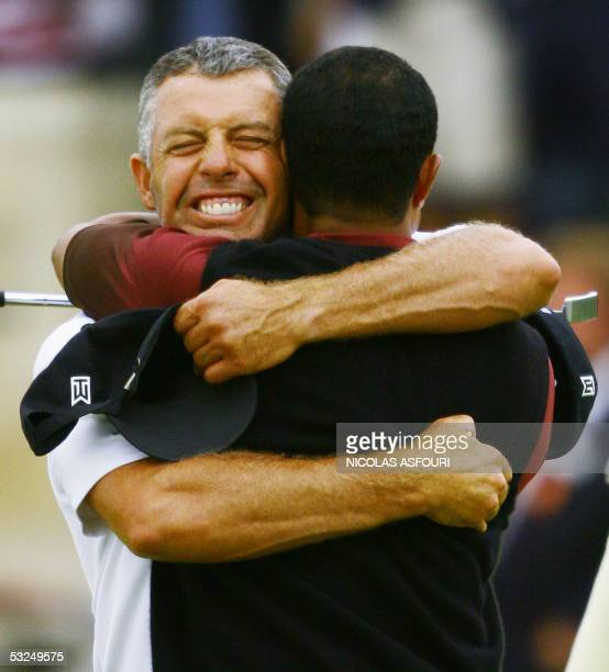 Tiger Woods of the US hugs caddie Steve Williams after winning the 134th Open Championship on the Old Course in St Andrews Scotland 17 July 2005 AFP...