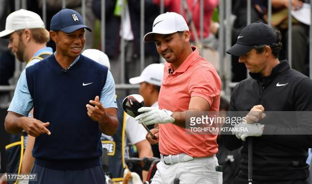 Tiger Woods of the US Jason Day of Australia and Rory McIlroy of Northern Ireland chat chat at the first hole tee at a Japan Skins prematch ahead of...