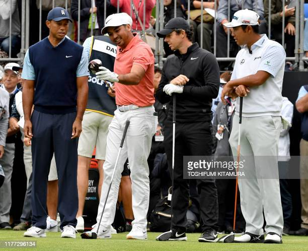 Tiger Woods of the US Jason Day of Australia Rory McIlroy of Northern Ireland and Hideki Matsuyama of Japan chat at the first hole tee at a Japan...