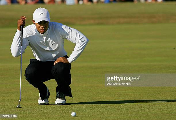 Tiger Woods of the US lines up a putt on the 13th green during the third round of the 134th Open Championship on the Old Course in St. Andrews,...