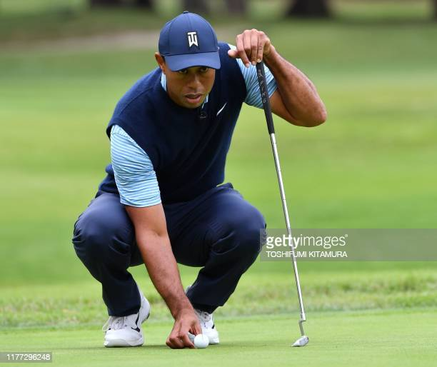 Tiger Woods of the US lines up a putt on the second hole green at a Japan Skins prematch ahead of the Zozo Championship golf tournament at the...