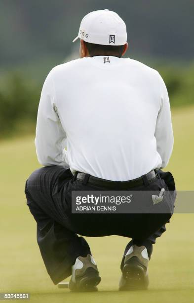 Tiger Woods of the US looks at his lie on the 5th green during the third round of the 134th Open Championship on the Old Course in St. Andrews,...