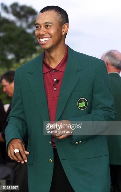 Tiger Woods of the US poses for photographers in his second green jacket 08 April 2001 after winning the 2001 Masters Golf Tournament at the Augusta...