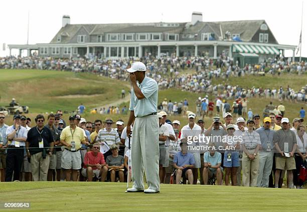 Tiger Woods of the US reacts after missing a birdie putt on the 8th green during the 1st round of play at the 2004 US Open Championship at Shinnecock...