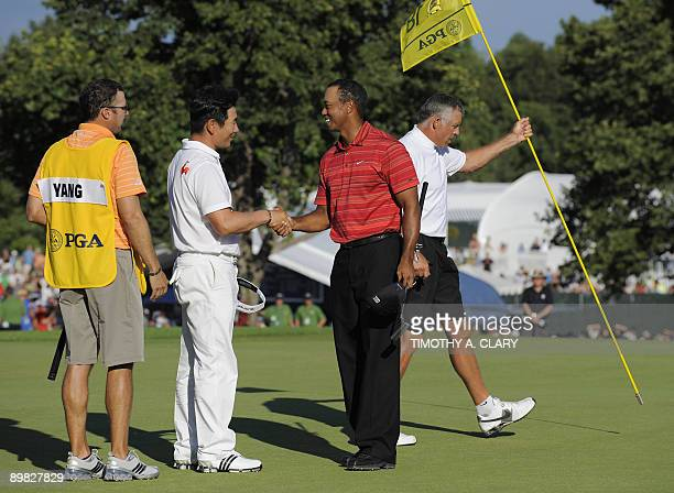 Tiger Woods of the US shakes hands with Y.E. Yang of South Korea after Yang wins August 16 ,2009 at the 91st PGA Championship at the Hazeltine...