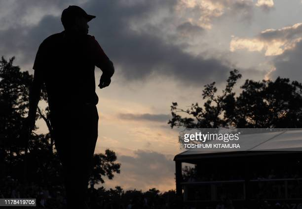 Tiger Woods of the US stands on the 9th hole green during the fourth round of the PGA Zozo Championship golf tournament at the Narashino Country Club...