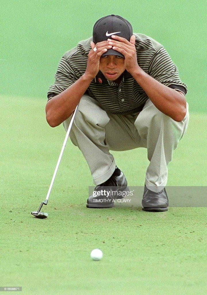Tiger Woods of the US studies his putt on the first green 12 April during the third round of the Masters Tournament at Augusta National Golf Club in Augusta, GA. Woods is leading the tournament with a score of 11-under-par.