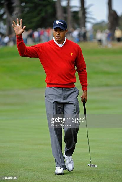 Tiger Woods of the U.S. Team birdies the second hole during the first round foursome matches for The Presidents Cup at Harding Park Golf Club on...