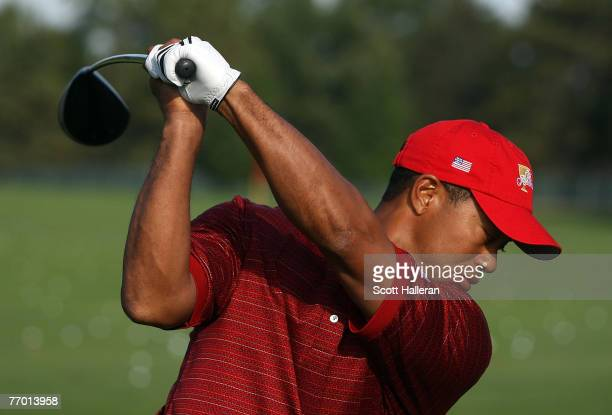Tiger Woods of the US Team hits a shot on the practice ground during practice prior to the start of the Presidents Cup at The Royal Montreal Golf...