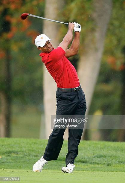 Tiger Woods of the US Team hits a shot on the seventh hole during the Day Three Foursome Matches at the Muirfield Village Golf Club on October 5 2013...