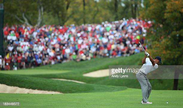 Tiger Woods of the US Team hits his approach shot on the 17th hole during the Day Four Singles Matches at the Muirfield Village Golf Club on October...