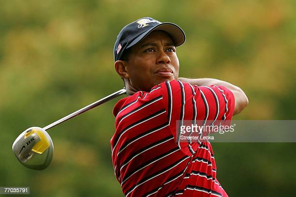 Tiger Woods of the U.S. Team hits off the 11th tee during practice prior to the start of The Presidents Cup at The Royal Montreal Golf Club on...