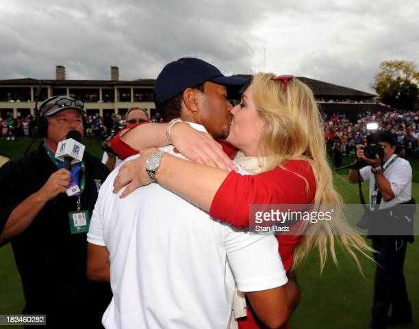 Tiger Woods of the US Team is congratulated by Lindsey Vonn after Woods 1up victory over Richard Sterne of the International Team won the Cup for the...