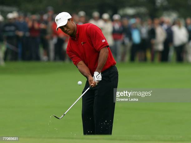 Tiger Woods of the US Team pitches to the first green during the round one foursome matches at The Presidents Cup at The Royal Montreal Golf Club on...