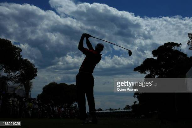 Tiger Woods of the US Team plays his tee shot on the 16th hole during the Day Two FourBall Matches of the 2011 Presidents Cup at Royal Melbourne Golf...