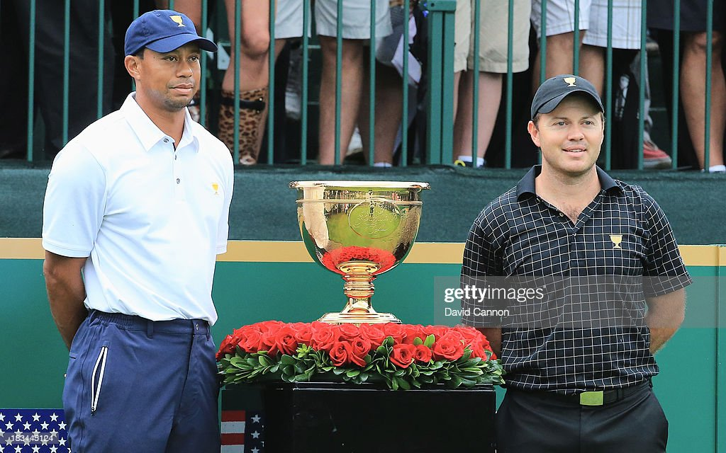 Tiger Woods of the U.S. Team (L) poses with Richard Sterne of South Africa and the International Team on the first tee during the Day Four Singles Matches at the Muirfield Village Golf Club on October 6, 2013 in Dublin, Ohio.
