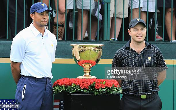 Tiger Woods of the U.S. Team poses with Richard Sterne of South Africa and the International Team on the first tee during the Day Four Singles...