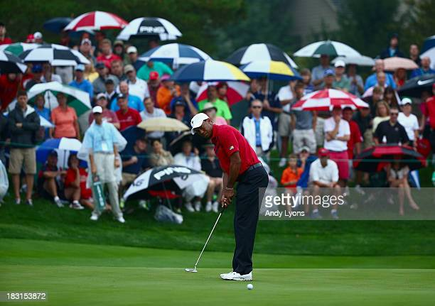 Tiger Woods of the US Team putts for eagle on the fifth green during the Day Three Fourball Matches at the Muirfield Village Golf Club on October 5...