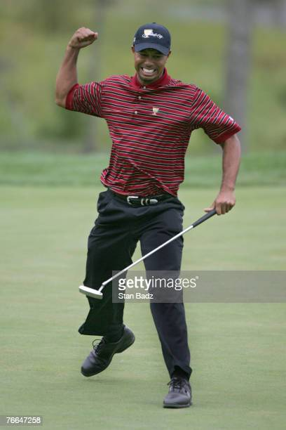 Tiger Woods of the US team reacts after making a birdie on the 16th hole to go 1 up against Vijay Singh and Stuart Appleby of the International team...