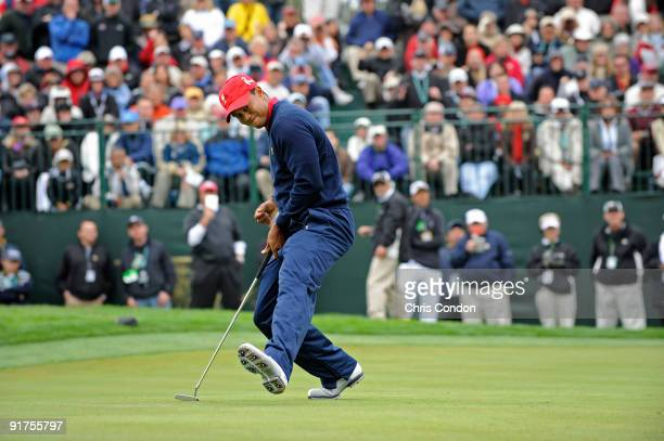 Tiger Woods of the U.S. Team reacts after sinking a birdie putt on during the final round singles matches for The Presidents Cup at Harding Park Golf...
