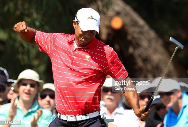 Tiger Woods of the U.S. Team reacts to his putt on the fourth hole during the Day Two Four-Ball Matches of the 2011 Presidents Cup at Royal Melbourne...