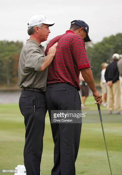 Tiger Woods of the US team receiving treatment for his injured back during the fourball matches in the third round of The Presidents Cup at Robert...