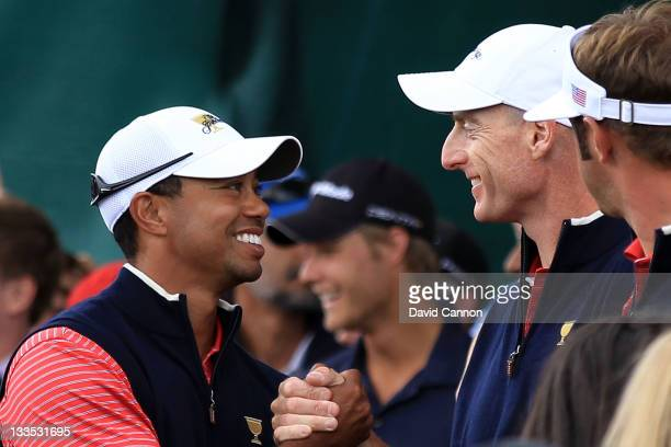 Tiger Woods of the US Team shakes hands with Jim Furyk of the US Team after winning his match on the 15th hole during the Day Four Singles Matches of...