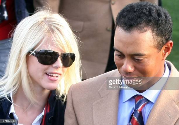 Tiger Woods of the U.S. Team walks with his wife Elin Woods during the opening ceremonies prior to the start of The Presidents Cup at The Royal...