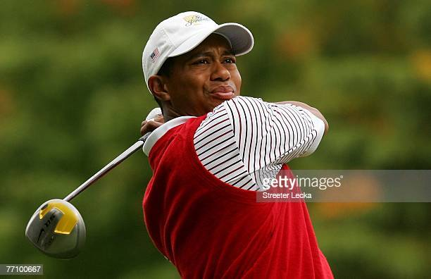Tiger Woods of the U.S. Team watches a tee shot on the 11th hole during the second round of fourball matches at The Presidents Cup at The Royal...