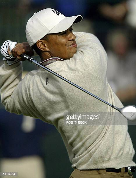 Tiger Woods of the US tees off at the 10th hole during the first round of the 86th PGA Championship at the Whistling Straits Golf Course in Kohler,...