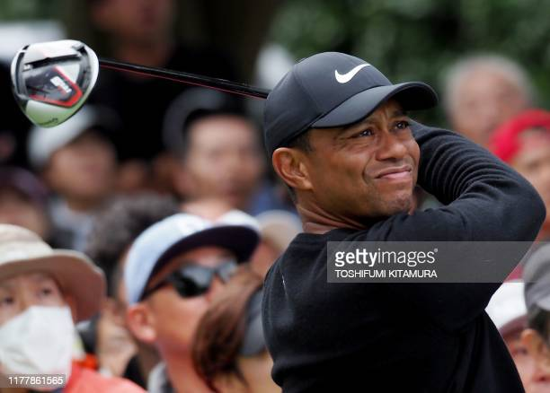 TOPSHOT Tiger Woods of the US tees off at the 6th hole during the first round of the Zozo Championship golf tournament at the Narashino Country Club...