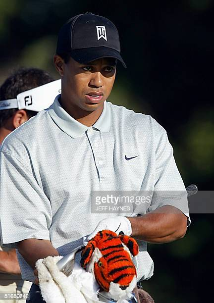Tiger Woods of the US waits to tee off during his practice round for the 2002 PGA Championship 14 August, 2002 at Hazeltine National Golf Club, in...