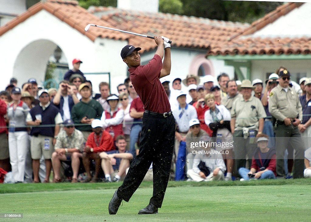 Tiger Woods of the US watches his approach shot on : News Photo