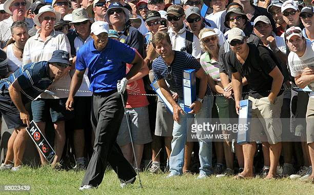 Tiger Woods of the US watches the flight of his ball during the second round of the Australian Masters being played at the Kingston Heath course, in...