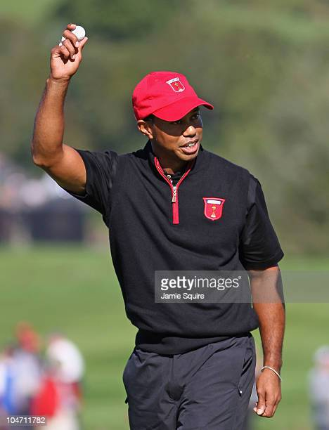 Tiger Woods of the USA acknowledges the crowd after holing out for an eagle on the 12th hole in the singles matches during the 2010 Ryder Cup at the...