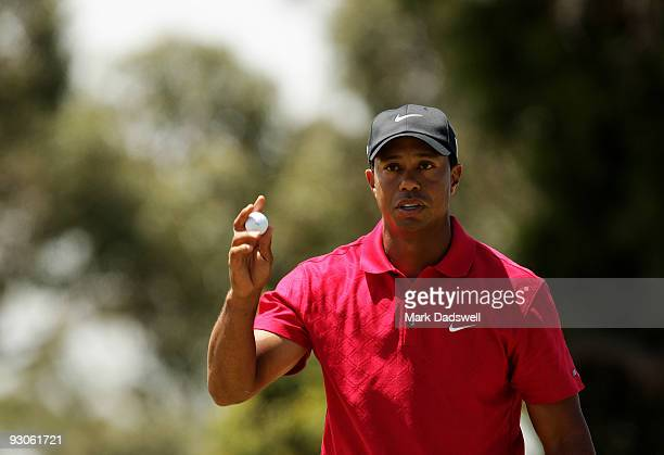 Tiger Woods of the USA acknowledges the crowd on the 5th hole during the final round of the 2009 Australian Masters at Kingston Heath Golf Club on...